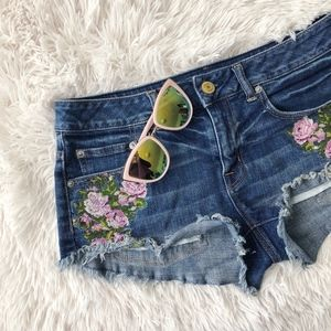 AEO blue raw hem floral embroidered jean shorts